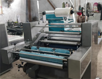 Laminated Roll to Sheet Separator Attached