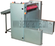 Laminated Roll to Sheet Cutter